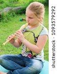 portrait of little girl playing ...   Shutterstock . vector #1093579292