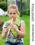 portrait of little girl playing ...   Shutterstock . vector #1093579316