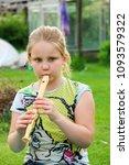 portrait of little girl playing ...   Shutterstock . vector #1093579322