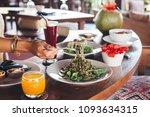 fresh green zucchini noodle... | Shutterstock . vector #1093634315