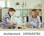 two little children playing... | Shutterstock . vector #1093650782