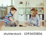 two little children playing... | Shutterstock . vector #1093650806