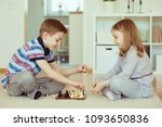 two little children playing... | Shutterstock . vector #1093650836