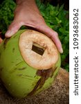 Small photo of Method of opening the coconut to drink the fresh water.