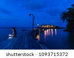 woman sitting on a wooden pier... | Shutterstock . vector #1093715372