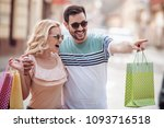 beautiful couple shopping in... | Shutterstock . vector #1093716518