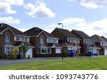a quiet suburban cul de sac... | Shutterstock . vector #1093743776