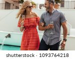 beautiful couple with glass of... | Shutterstock . vector #1093764218