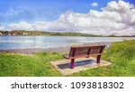 a lonely bench in a quay near... | Shutterstock . vector #1093818302