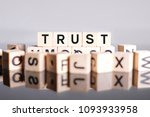 trust word cube on reflection | Shutterstock . vector #1093933958