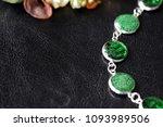 green resin bracelet on a dark... | Shutterstock . vector #1093989506