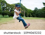 girl playing in the park | Shutterstock . vector #1094065232