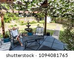 young man lying down on patio... | Shutterstock . vector #1094081765