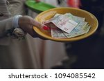Small photo of Lots Of Cold Cash In A Warm Colored Bowl Over