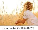 kid at wheat field hugging... | Shutterstock . vector #109410392