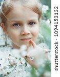little girl near cherry blossom. | Shutterstock . vector #1094153132