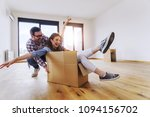 happy young couple just moved... | Shutterstock . vector #1094156702