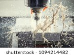 Milling metalworking process. Industrial CNC metal machining by vertical mill. Coolant and lubrication - stock photo