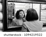 a young woman looks at her... | Shutterstock . vector #1094219522