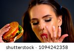 woman eating hamburger. girl... | Shutterstock . vector #1094242358