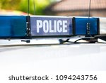 police sign and lights on roof... | Shutterstock . vector #1094243756