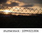 photo of a mesh fence on a... | Shutterstock . vector #1094321306