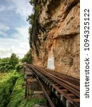 Small photo of Railway alongside cliff and river in Kanchanaburi of Thailand as know as Death bridge since WWII