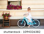 beautiful young girl in a white ... | Shutterstock . vector #1094326382