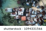 poor slums like this are at... | Shutterstock . vector #1094331566