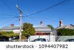 A row of detached houses in a...