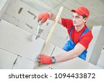 walling. bricklayer installing... | Shutterstock . vector #1094433872