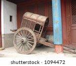 Ancient Chinese Rickshaw on display in Xian, China - stock photo