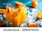 fresh orange juice in glasses ... | Shutterstock . vector #1094474192