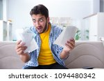 man angry at bills he needs to... | Shutterstock . vector #1094480342