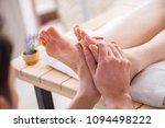 foot massage in medical spa | Shutterstock . vector #1094498222