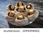 peeled champignons in a plate... | Shutterstock . vector #1094498402