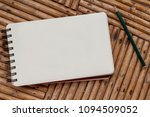 blank notebook with pencil on... | Shutterstock . vector #1094509052