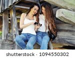 two girls with a smartphone... | Shutterstock . vector #1094550302