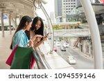 happy friends browsing retail... | Shutterstock . vector #1094559146