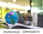 world globe on text book.... | Shutterstock . vector #1094568572