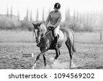 a girl jockey rides a horse | Shutterstock . vector #1094569202
