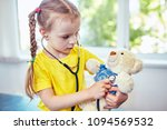portrait of cute little girl... | Shutterstock . vector #1094569532