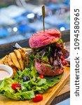 a vegetarian pink burger close... | Shutterstock . vector #1094580965