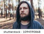 a young man with a beard walks...   Shutterstock . vector #1094590868