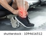 asian man injury ankle pain... | Shutterstock . vector #1094616512