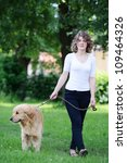 Stock photo woman walking a dog 109464326