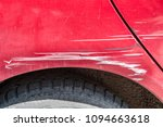 red scratched car with damaged... | Shutterstock . vector #1094663618