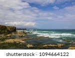 view of the sea with the rocks... | Shutterstock . vector #1094664122