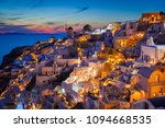 classic view of sunset over oia ... | Shutterstock . vector #1094668535