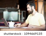 young bearded manager or... | Shutterstock . vector #1094669135